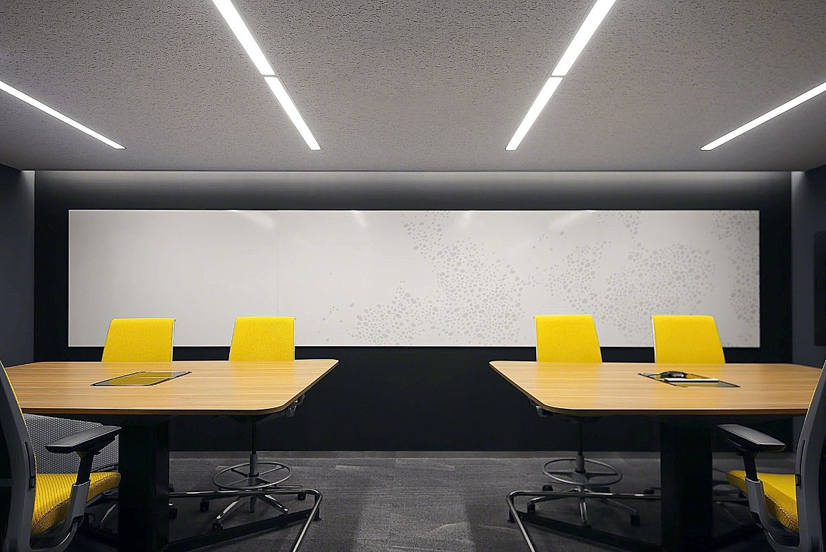 Front view of PolyVision's high gloss white a3 CeramicSteel Sans panels with surface imaging on the wall near two tables with yellow chairs.