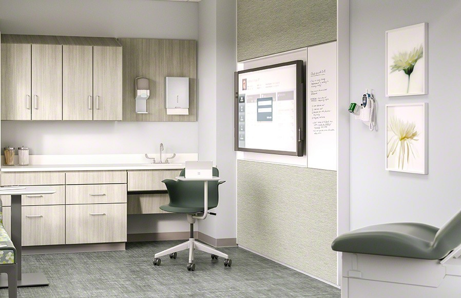 Modern doctor's office with office chair, patient's chair, cabinets, and display screen