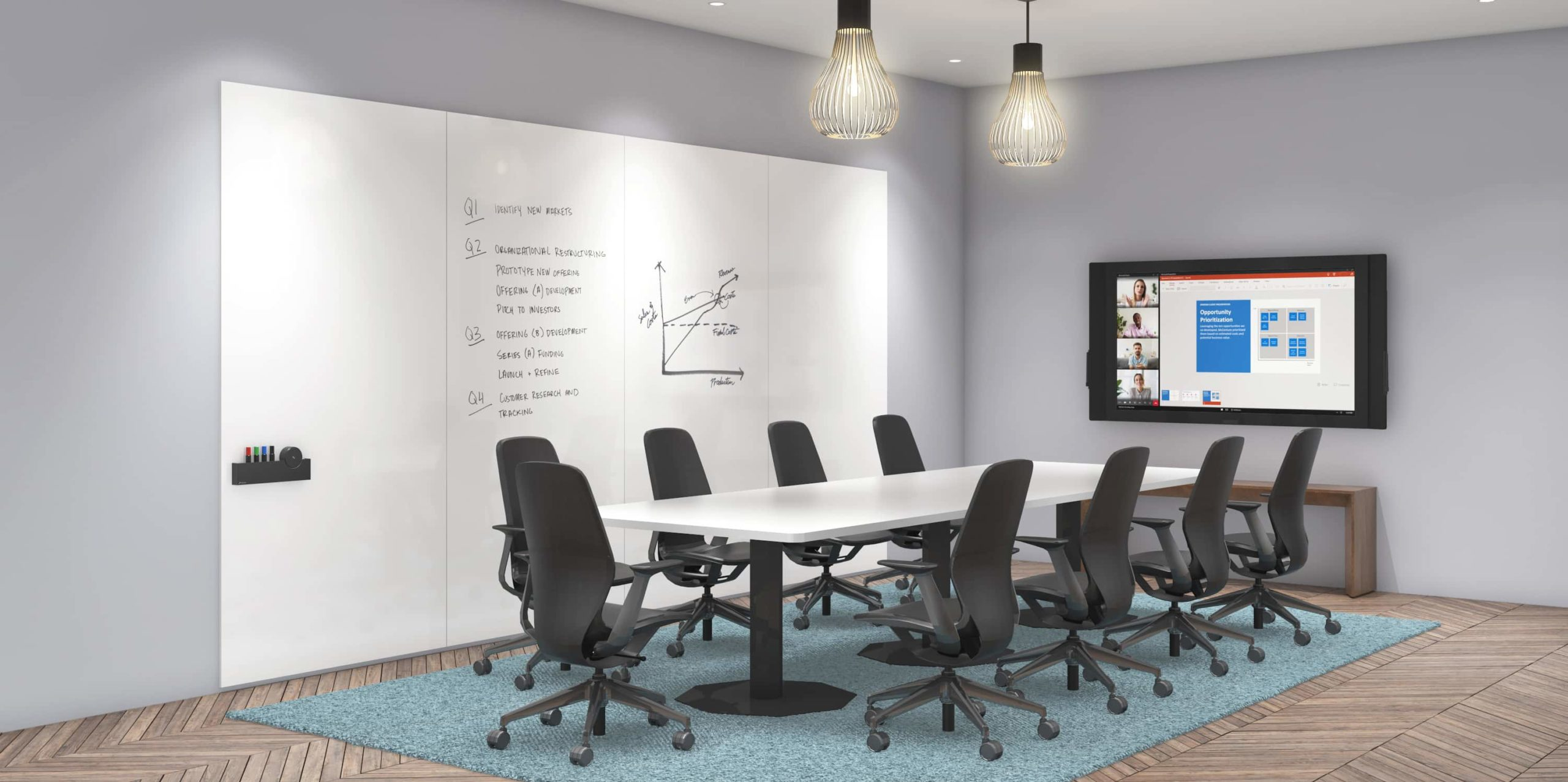 Meeting area with a long white table and black high-back chairs in front of a wall-mounted frameless whiteboard