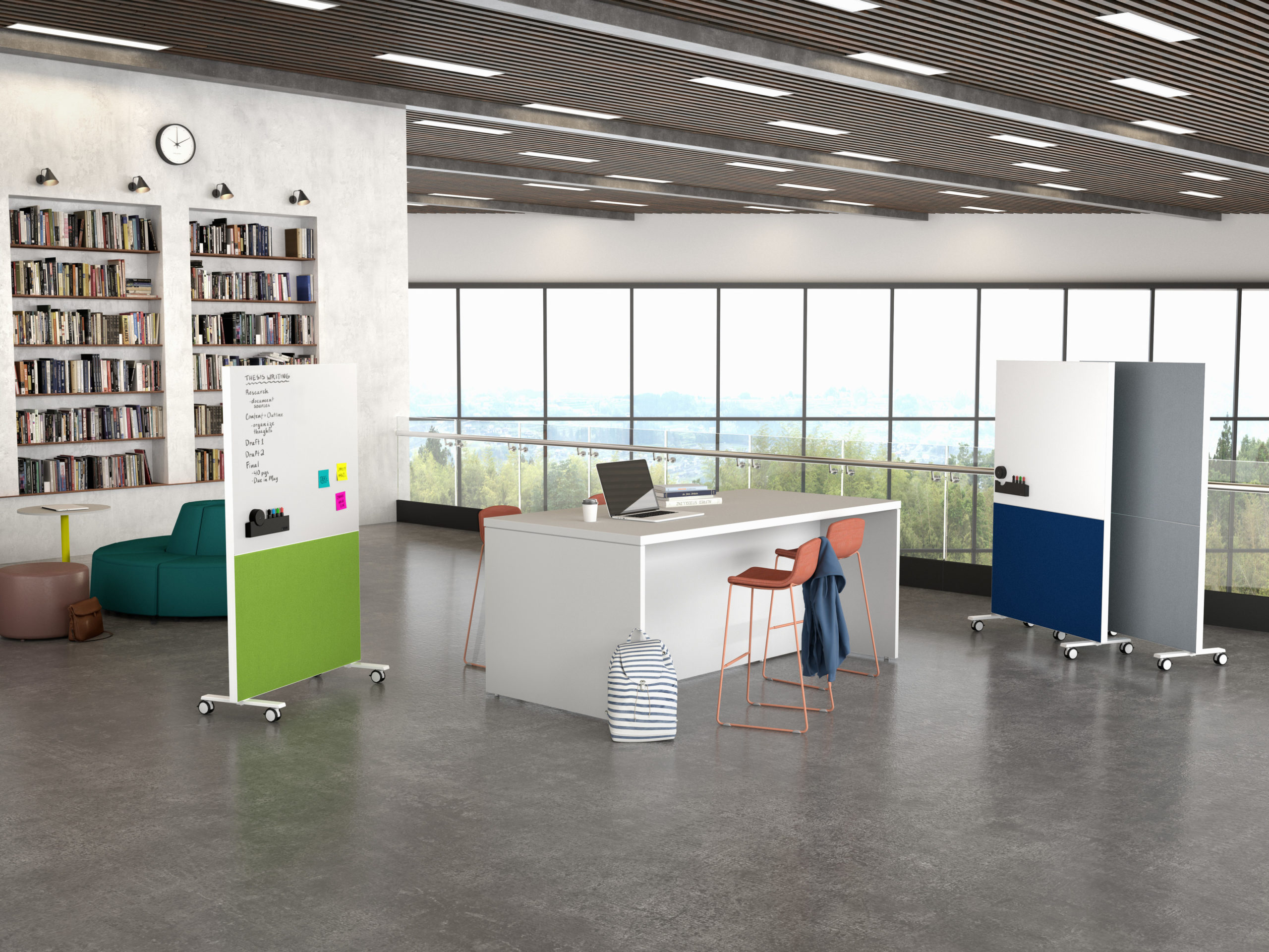 Collaborative office area with large table, stools, and mobile whiteboards